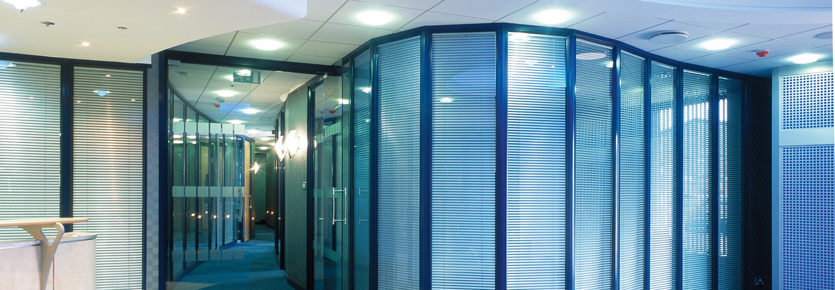 Corporate Interiors Design and Build - Management Team - curved glass partition in office