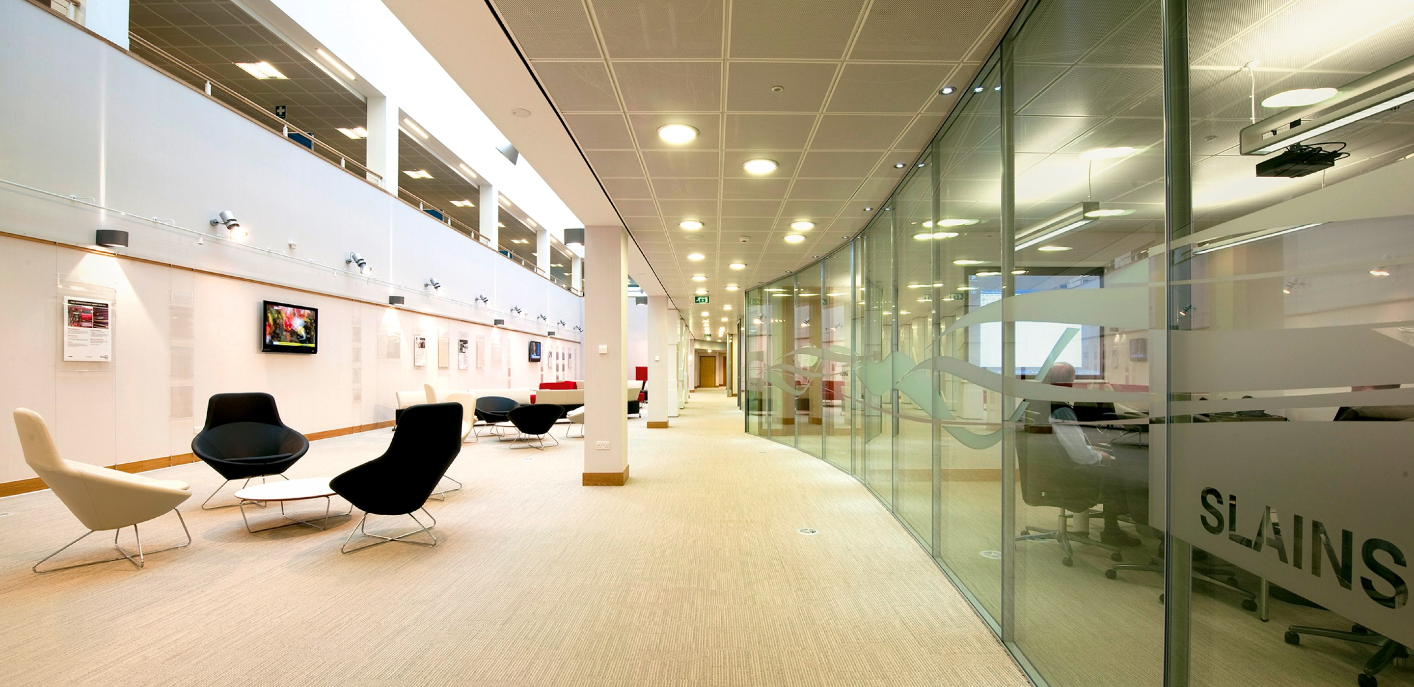 Corporate Interiors Design and Build - Large office lobby area with glass partition