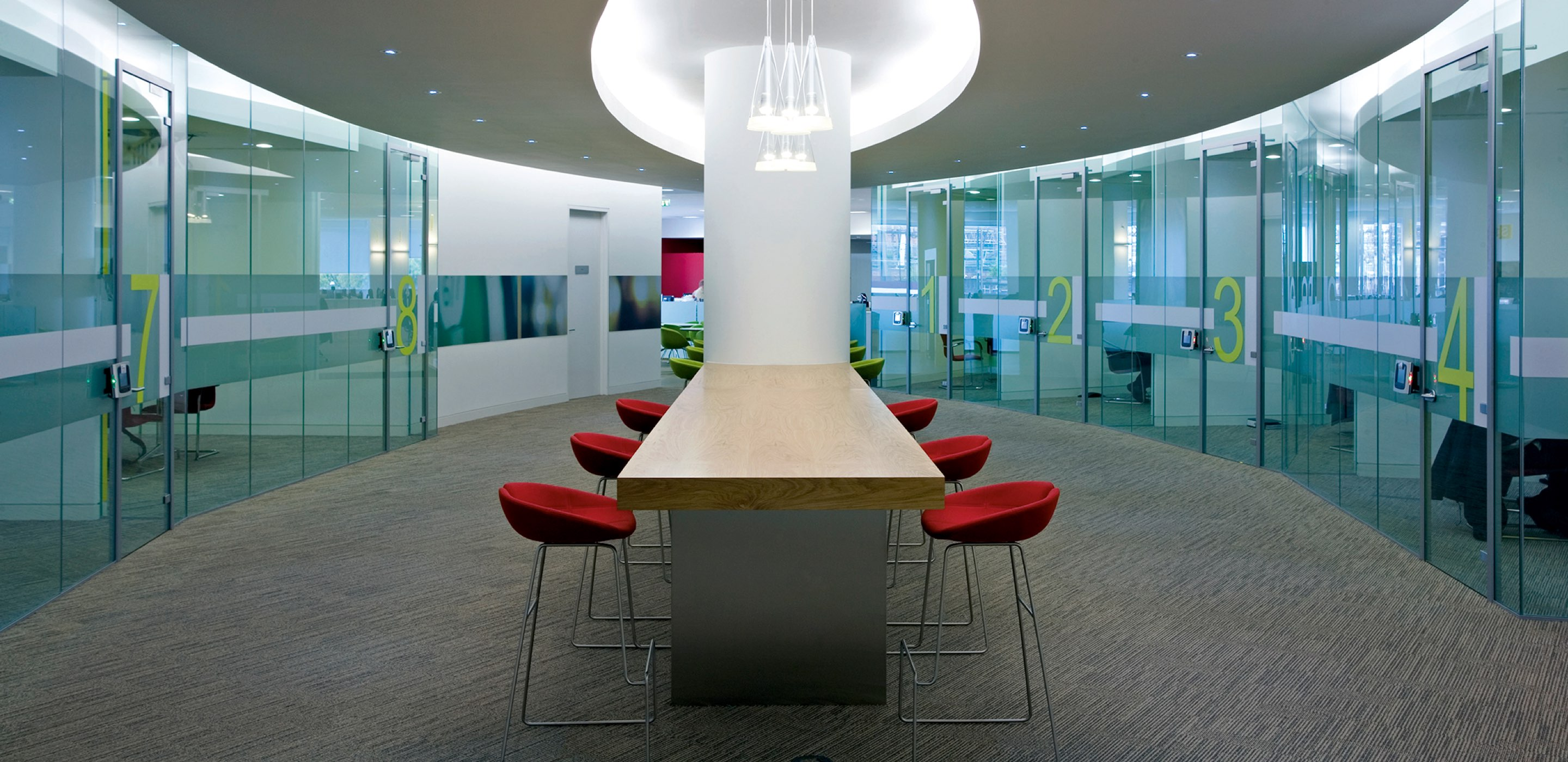 Corporate Interiors Design and Build - Modern meeting space with glass partitions
