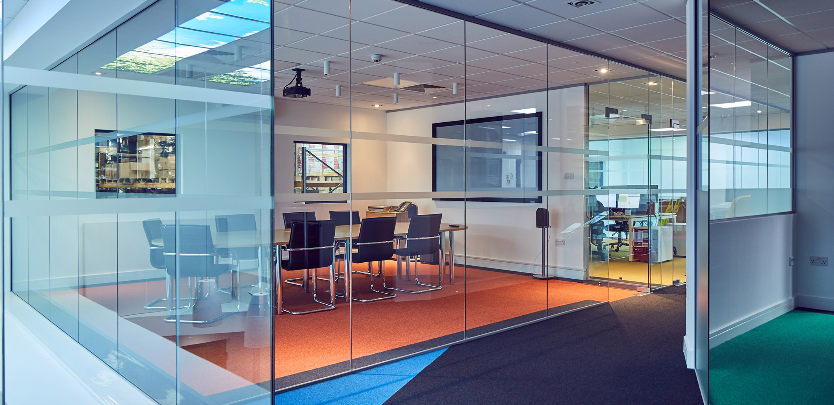Corporate Interiors Design and Build - Modern office meeting room with glass walls