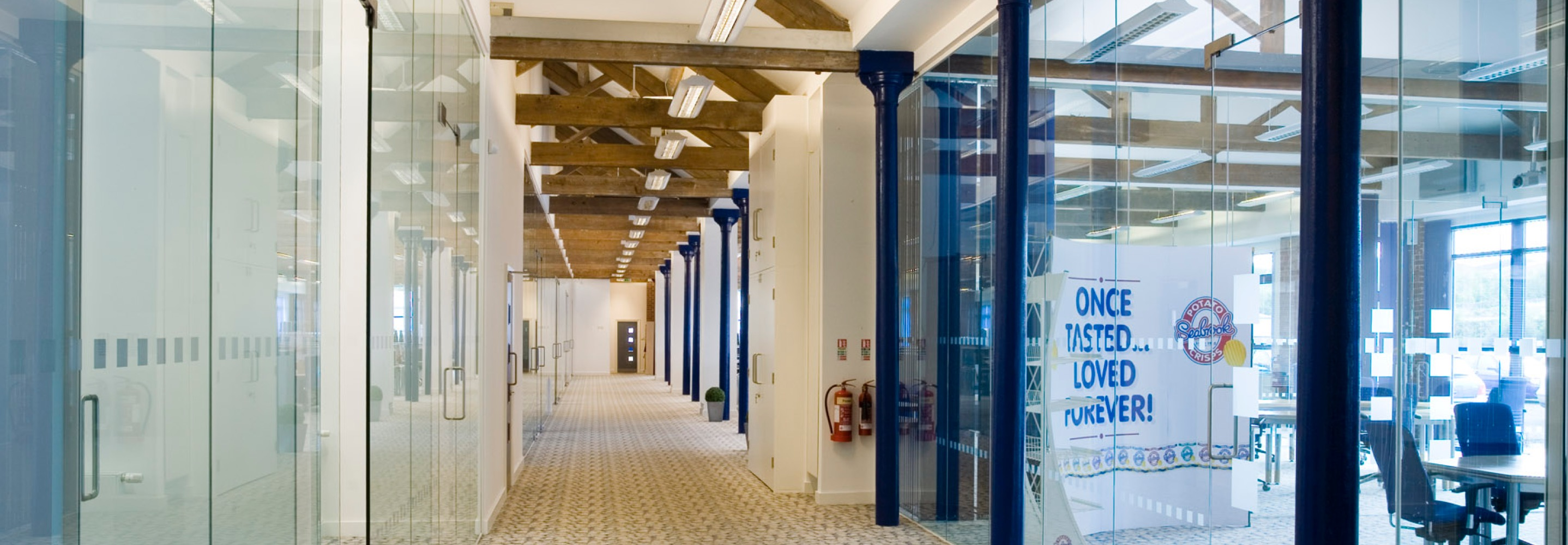 Corporate Interiors Design and Build - Quality and Accreditations - corridor in vaulted beamed office